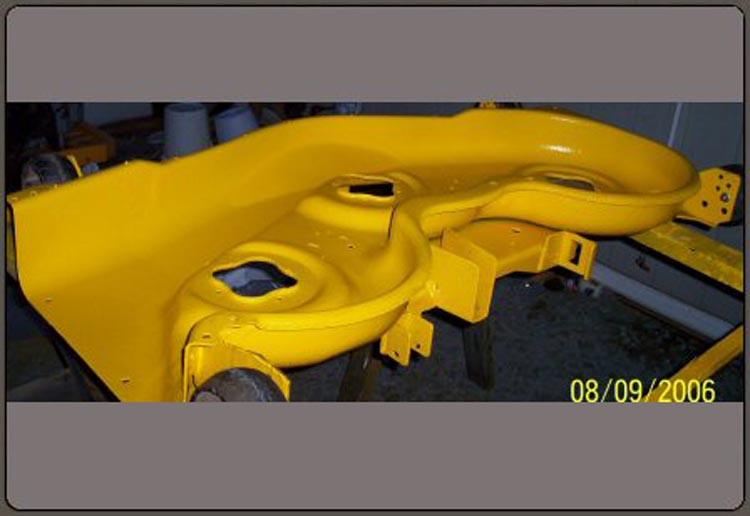 Yellow Speedliner Spray on Liner on Lawn Mower Deck